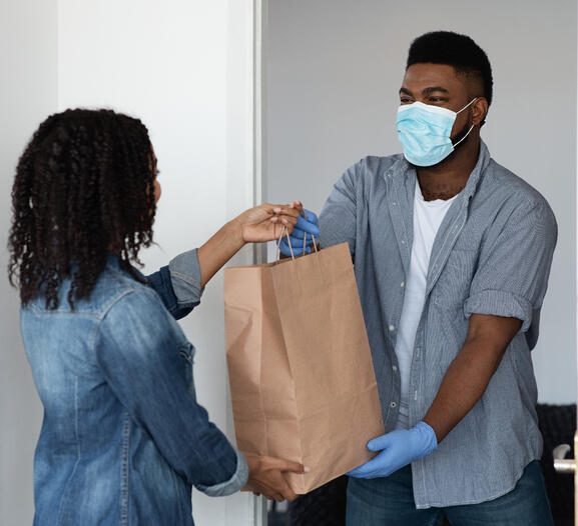 Masked african americans delivering goods cropped